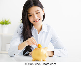 young business woman with piggybank
