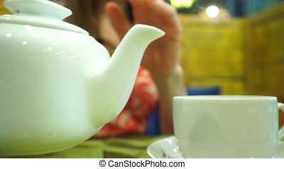 Girl having her green tea in a cafe, close up shot - Cute...