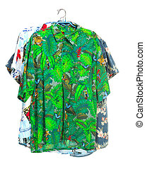 The isolated tropical shirts on white - The three isolated...