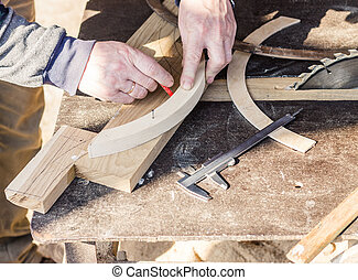 Carpenter is making furniture - Carpenter is measuring...