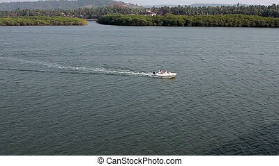 Motor boat with people in open waters