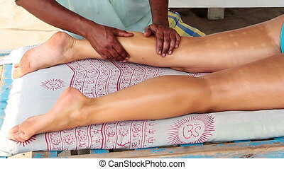 therapists hands doing legs massage - Close up of...