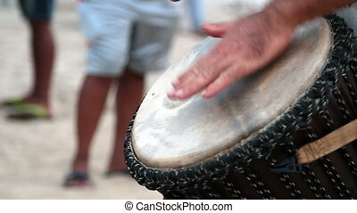 man playing on drum
