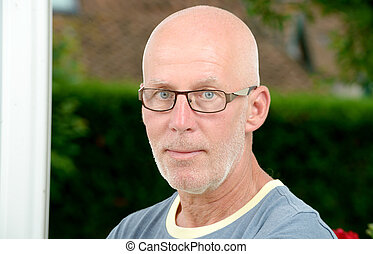 portrait of a mature man with glasses - a portrait of a...