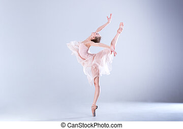 Modern Ballet - Young ballerina is dancing in a white studio...