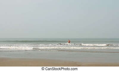 man swimming on the beach - Happy young man swimming on the...