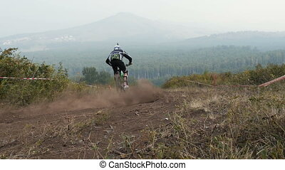 Sport athlete man downhill bike riding mountain trail
