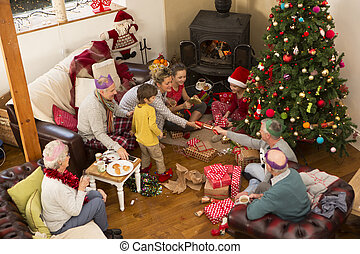 Christmas Morning - A family are sat around a christmas...