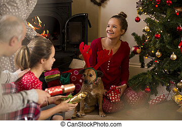 Family Christmas Morning - Family opening presents on...