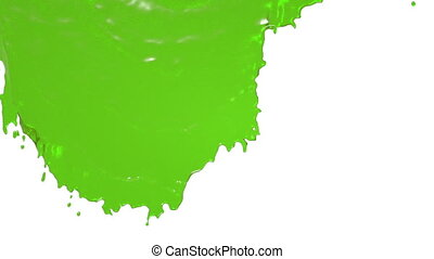 green paint flowing down slowly - close-up view of green...