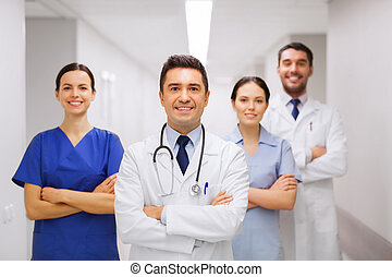 happy group of medics or doctors at hospital - clinic,...