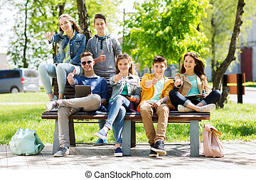 group of students with tablet pc at school yard