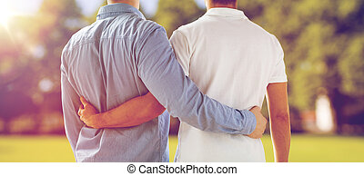 close up of happy male gay couple hugging - Happy male gay...