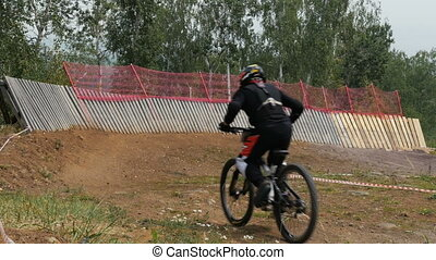 athlete a cyclist competitions in downhill riding Insloped...