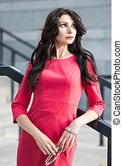 Pretty brunette in red dress