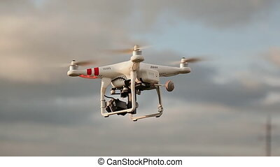 Drone With Camera Flying On The Evening Sky. - Drone With...