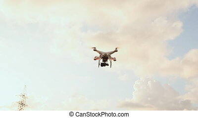 Quadcopter With Camera Flying On The Evening Sky - Drone...