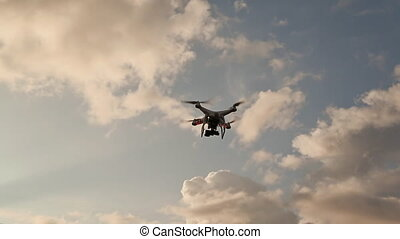 Drone With Camera Flying On Sunset - Quadcopter With Camera...