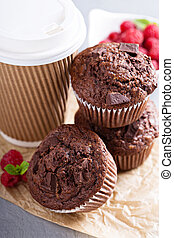 Chocolate muffins with coffee to go for breakfast