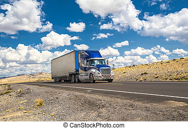 Blue truck moving on a highway