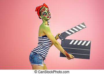 thriller pin-up - Pin-up zombie woman holding clapperboard...