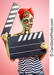 movie star - Pin-up zombie woman holding clapperboard over...