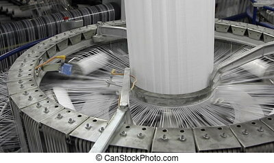 yarn spools on spinning machine