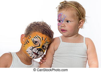 very cute and lovely brother and sister with facepainting of...