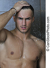 good looking man under man shower - young good looking and...