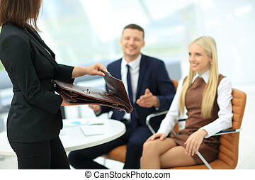 Business woman holding a briefcase - Businesswoman showing...