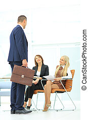 Business man holding a briefcase - Full body portrait of a...