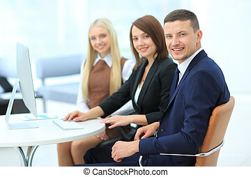 Businesspeople Having Meeting Around Table In Modern Office...