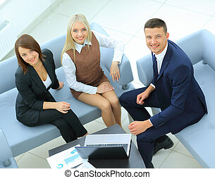 Businesspeople Having Meeting In Office - A group of...