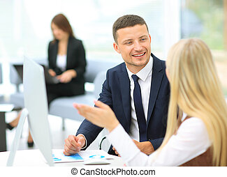 Businesspeople Having Meeting In Office - Young...