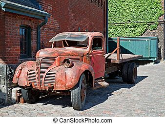 Old truck - An old truck parked outside a building in the...