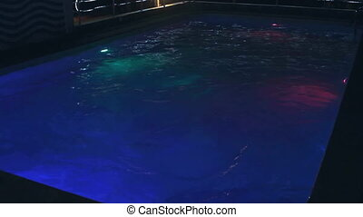 swimming pool at luxury hotel in night illumination
