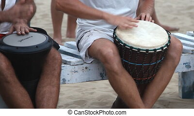 Unidentified man playing on drum