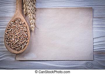Golden wheat rye ears corn wooden spoon vintage paper sheet...