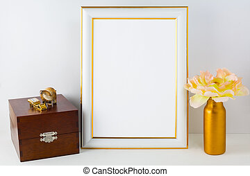 Frame mockup with wooden box and golden vase - Frame mockup...
