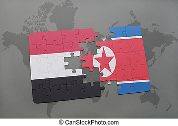 puzzle with the national flag of yemen and north korea on a...