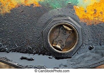 Barrel - Detail of a rusty, leaking oil barrel
