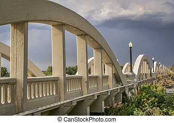 Concrete arch bridge over South Platte River - Rainbow arch...