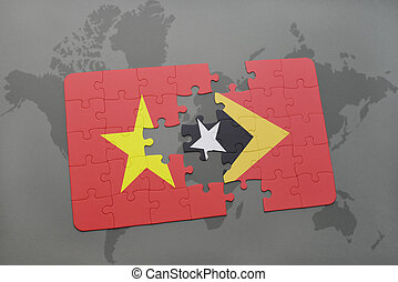 puzzle with the national flag of vietnam and east timor on a world map background.