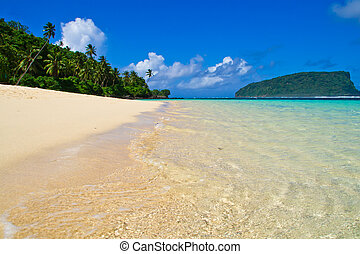 tropical beach island panorama - white sand beach with blue...