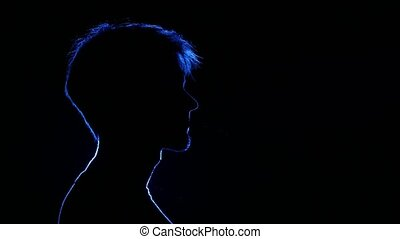 Man lighting cigarette. Back light. Silhouette - Man...