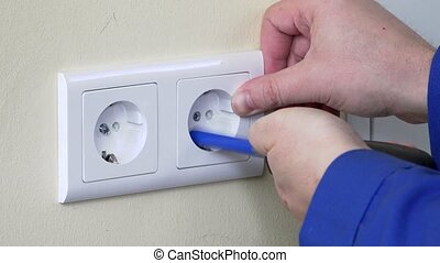 hands with screwdriver install outlet on wall - hands with...
