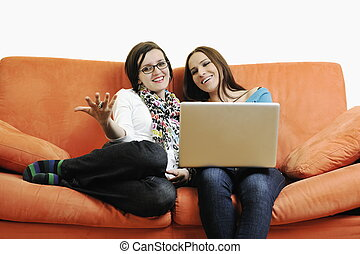 internet surfing and everyday computing - two happy young...
