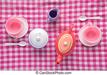 Flat lay Tea Party cookery on pink checkered tablecloth....