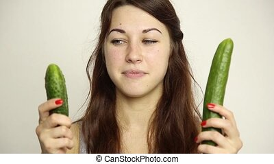 beautiful young woman eating an vegetables. selection, small...