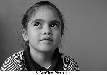 Young girl thinks about her future - Young girl (age 6)...
